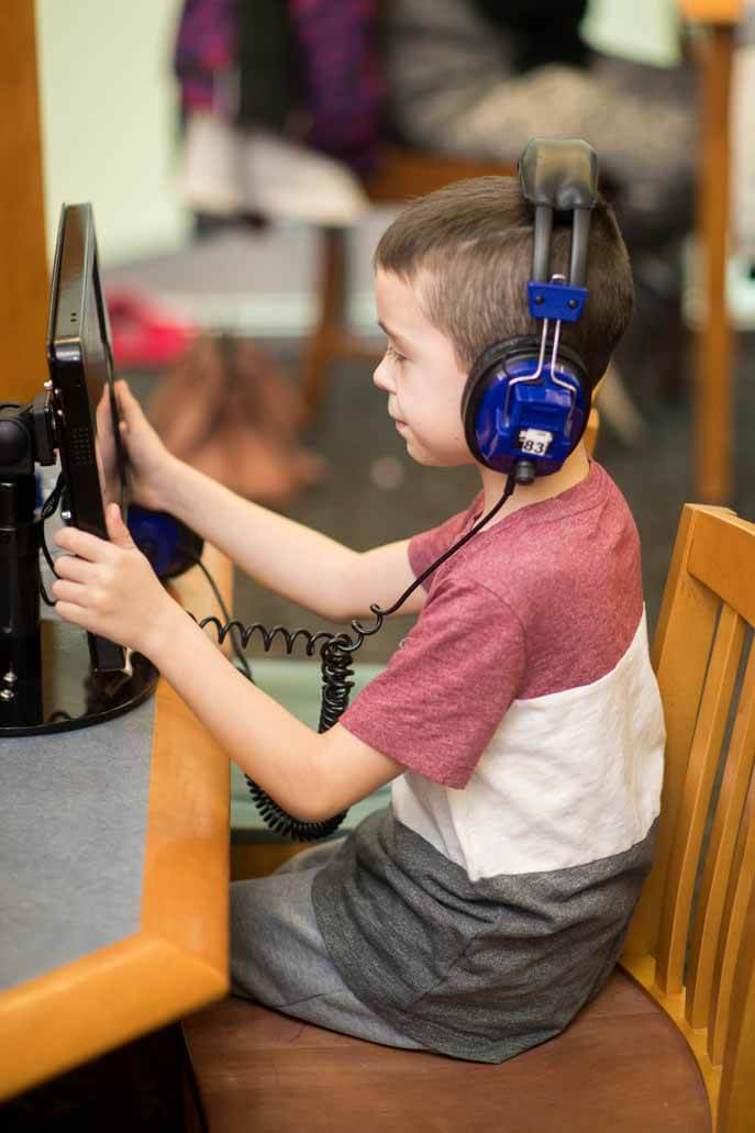 Boy at computer in Children's Library
