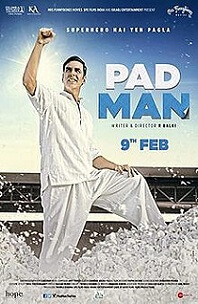 Padman; man dressed in white standing on top of mound of white cotton