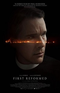 First Reformed; face of man dressed as priest with very serious look on face