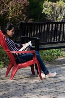 teen reading in garden