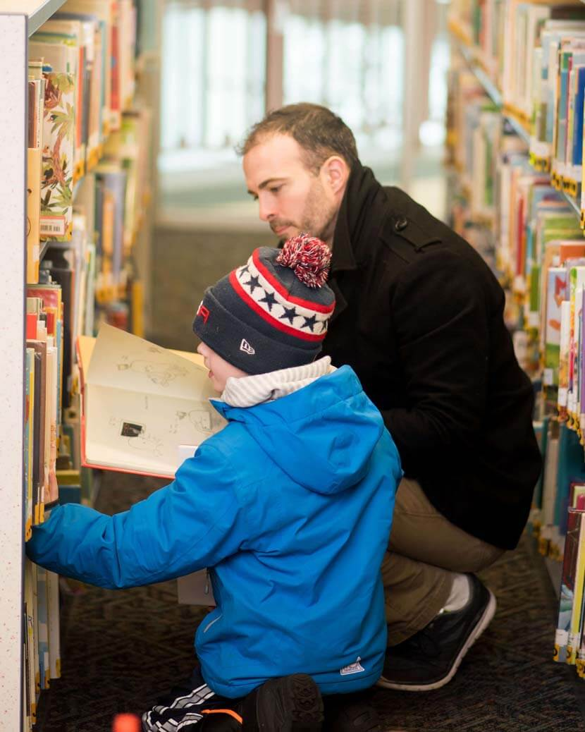 Father and son look for books